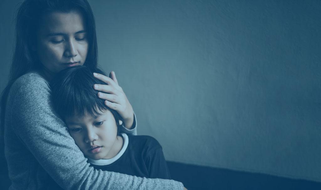 sad mom comforting her son
