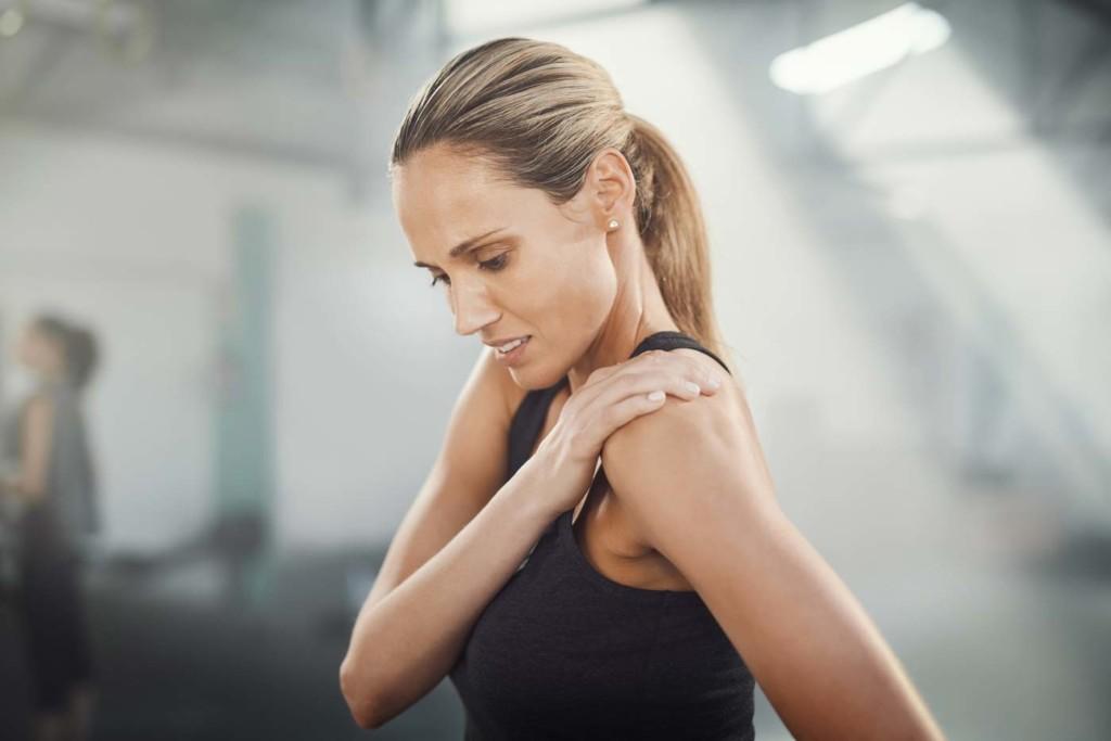 Woman nursing shoulder injury